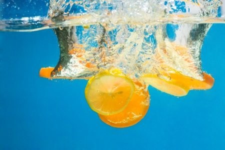 Orange splashing in water with blue background Stock Photo - 15541133