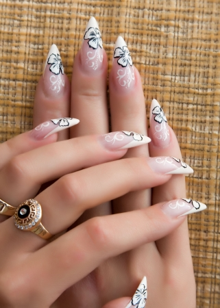 manicure salon: Female hands, nails with beautiful Art manicure