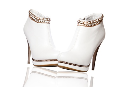A pair of beautiful white women's ankle boots high-heeled photo