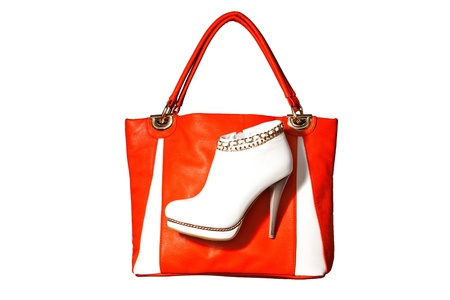 A pair of beautiful white womens ankle boots high-heeled and orange handbag