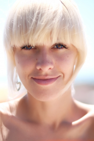 Portrait of a pretty blonde girl with blue eyes
