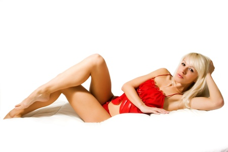 Beautiful sexy girl lying in a red lingerie Stock Photo