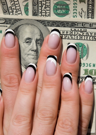 Female hands, nails with beautiful Art manicure on money Stock Photo