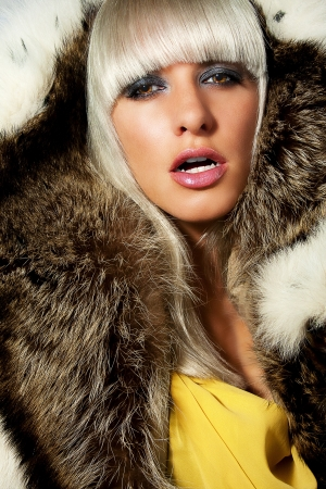 Portrait of a sexy beautiful blonde in fur, fanged photo