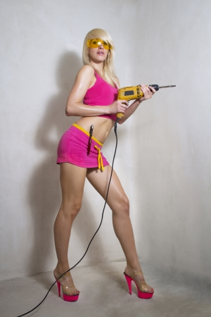 Sexy blonde girl builder with a drill photo