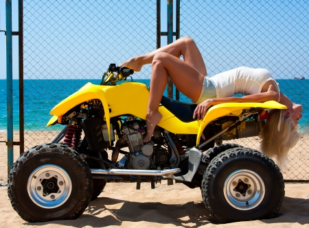 quad: Beautiful sexy blonde on the quad on the beach