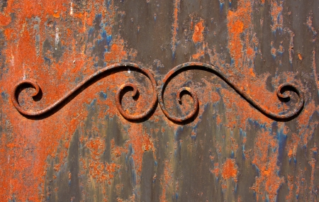 Wrought iron door element coated with rust photo
