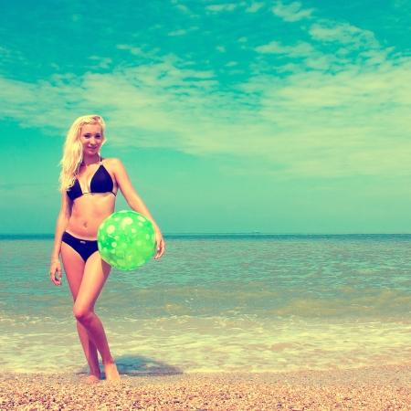 Beautiful woman on the beach playing ball Stock Photo - 20646180