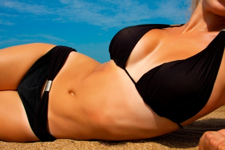 beauty breast: A girl with a beautiful slender figure against the sea