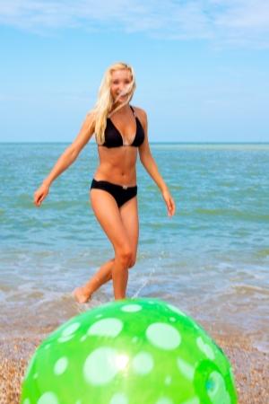 beach ball girl: Beautiful woman on the beach playing ball