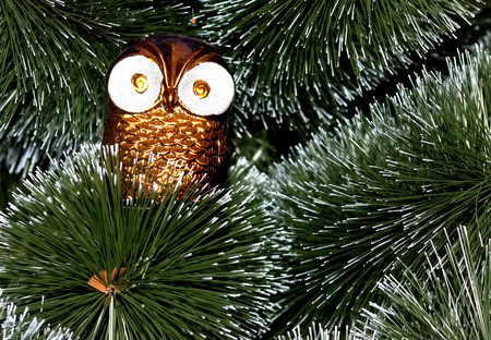 Christmas tree decorated with toys owl deer photo