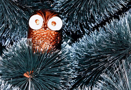 Christmas tree decorated with toys owl deer 스톡 사진
