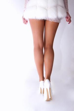 Beautiful female legs in high heels photo