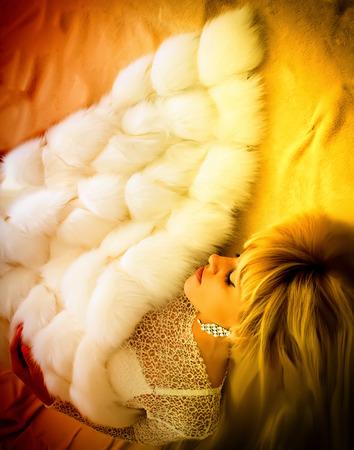 Blonde sleeping sheltered fur blanket Stock Photo