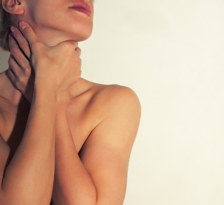 collarbone: Hands strangle a female slender neck. Girl pants, lack of air. Stock Photo