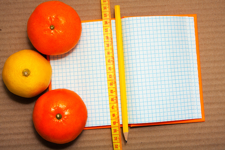 Notepads with fresh fruit around. Healthy lifestyle. Diet. Stock Photo