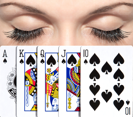 The woman got the best combination in poker. The peak royal flush. Beautiful eyes.