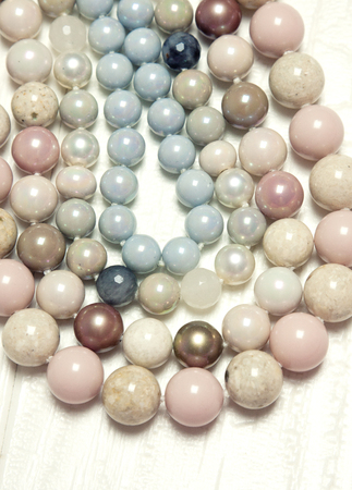 Interlacing of the nitium of beautiful colored pearls. Many pearls.