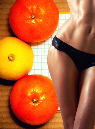 Beautiful tanned woman's body in sexy underwear. Abdomen, waist, legs. A healthy lifestyle