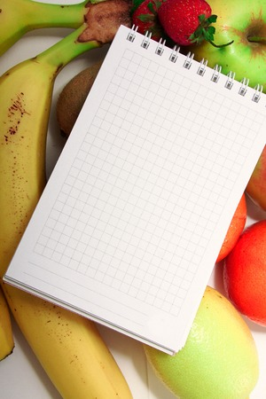 Healthy eating of diet meal plan with Workout and fitness dieting ,fitness and weight loss concept, fruit, Vegetable and notebook. Food and health Banque d'images