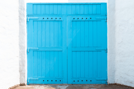 Closed blue door with frame Isolated on white background