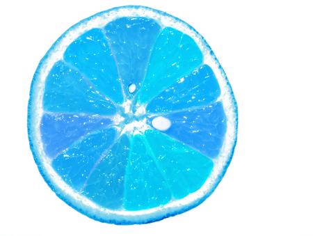 sliced blue orange fruit isolated on white background, pop art color concept Banque d'images