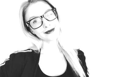 Beautiful woman in glasses smiling, Change of emotions. Black and white sketch. Standard-Bild