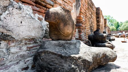 Buddha statue in an old temple and traces of decay of the historical city of Thailand.