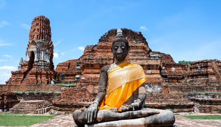 The Buddha statue in the temple has decaying and is old.