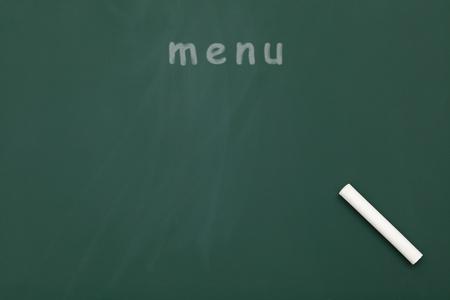 menu written with chalk in a blackboard  photo