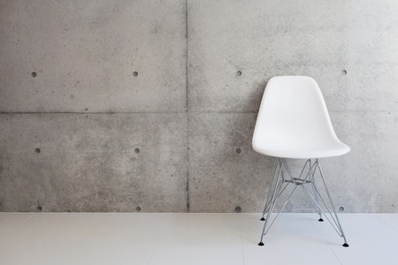 chairs: white chair and concrete wall  Stock Photo