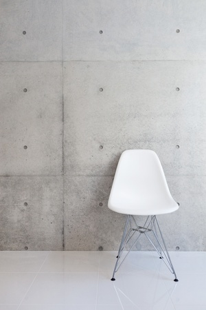 vintage chair: white chair and concrete wall  Stock Photo