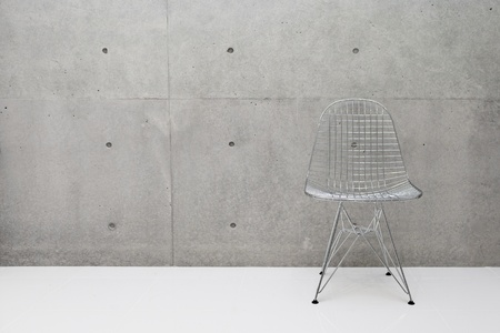 wire chair and concrete wall Stock Photo - 13526009