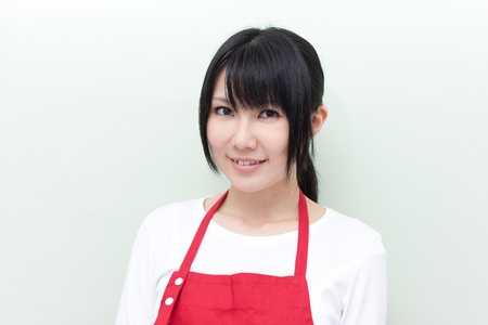 retailer: young woman with apron  Stock Photo