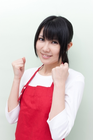 young woman with apron Stock Photo - 14001585