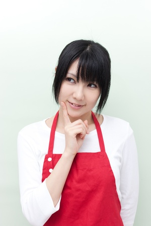 young woman with apron thinking  photo