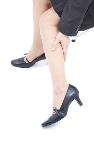 Women massaging tired legs, isolated on white background photo