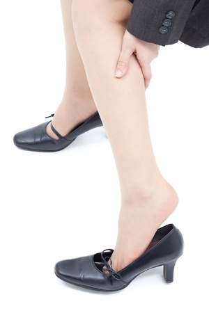 leg calf injury: Women massaging tired legs, isolated on white background