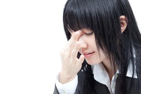eyestrain: businesswoman with tired eyes, isolated on white background