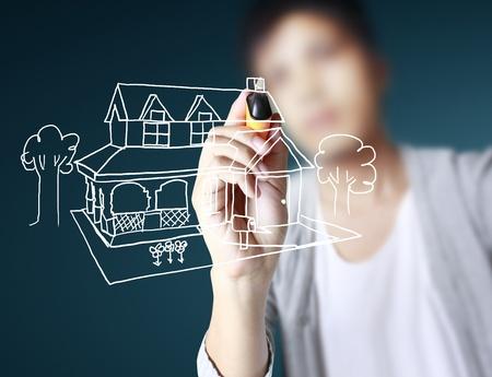 hand tekenen huis in een whiteboard  Stockfoto