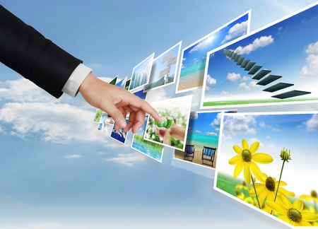hand pushing on a touch screen interface Stock Photo - 9726305