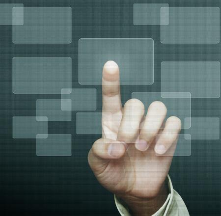 dotykový displej: hand pushing on a touch screen interface