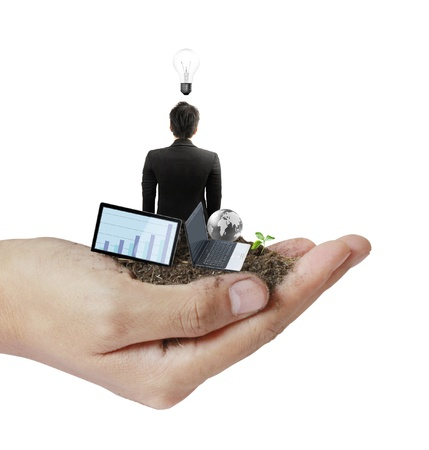 person holding a business, the soil in his hand  photo