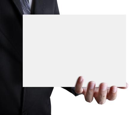 Businessman holding white billboard  Stock Photo - 9814776