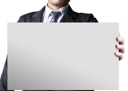 Businessman holding white billboard Stock Photo