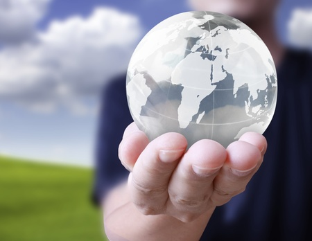holding a glowing earth globe in his hands Stock Photo - 9859864