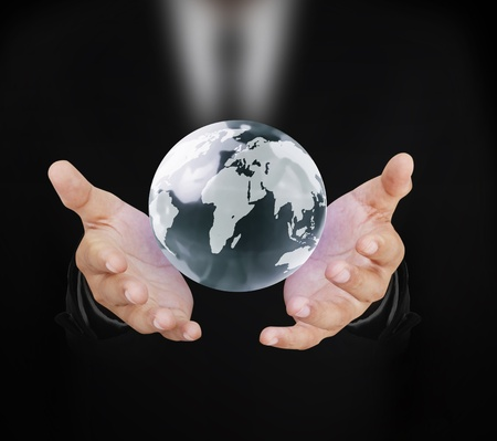 the humanities landscape: globe and hand  Stock Photo