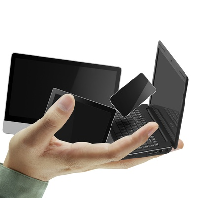 Mobile phones and laptops in hand Stock Photo - 10046533