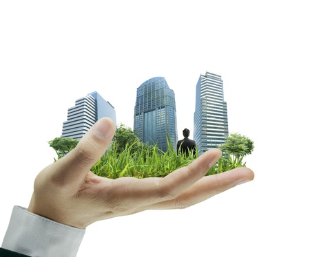 person holding a business, building on hand  photo