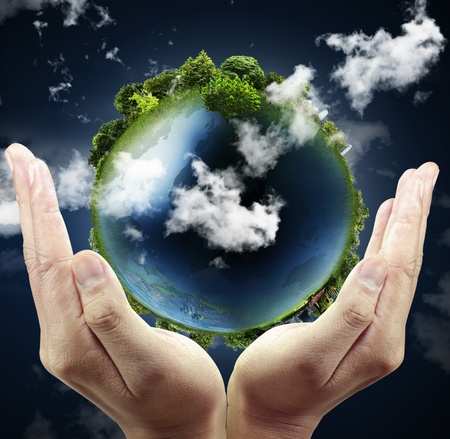 save earth: holding a glowing earth globe in his hands